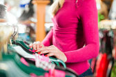 Woman is buying Tracht or dirndl in a shop — Stock Photo