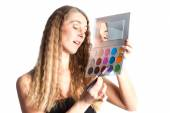 Woman putting make-up — Stock Photo