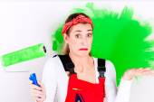 Woman at home improvement and painting — Stok fotoğraf