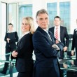 Business - team in an office — Stock Photo #72328135
