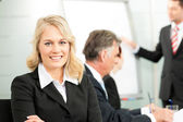 Business people - presentation within a team — Stock Photo
