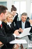 Business - team meeting in an office — Stock Photo