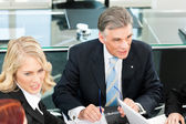 Business people - team meeting in an office — Stock Photo