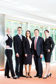Business - group of businesspeople in office — Stock Photo