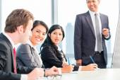 Asian business team in presentation — Stock Photo