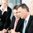 Business team looking at news or numbers — Stock Photo #72966551