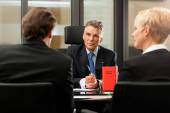 Lawyer or notary with clients in his office — Stock Photo
