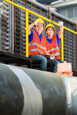 Asian technicians or workers on construction site — Stock Photo