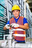 Chinese Technician working on valve — Stock Photo