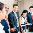 Business team at meeting — Stock Photo #73120781