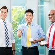 Three businessmen showing the thumbs up — Stock Photo #73120881