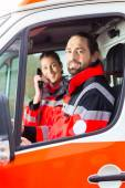 Emergency doctor driving in ambulance — Stock Photo