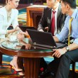 Business people at meeting in hotel lobby — Stock Photo #77909146