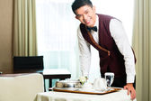 Room service waiter serving food in hotel — Stock Photo