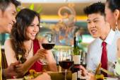 Chinese couples toasting with wine in restaurant — ストック写真