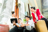Business people meeting in hotel lobby — Stock Photo