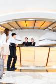Asian Chinese couple arriving at hotel — Stock Photo