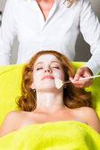 Cosmetics and Beauty - applying facial mask — Stock Photo
