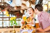 Couple drinking wheat beer in Bavarian restaurant — Stock Photo