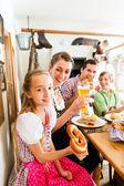 Bavarian family in German restaurant — Stock Photo