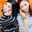 Two Asian girlfriends with phone — Stock Photo #79101964