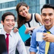 Asian businesspeople working outside with coffee — Stock Photo #79106306