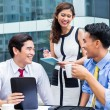 Asian businesspeople working outside with coffee — Stock Photo #79106314