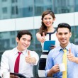 Asian businesspeople working outside with coffee — Stock Photo #79106322