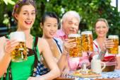 In Beer garden - friends drinking beer in bavaria — Stock Photo