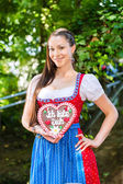 Woman with gingerbread hart in Bavaria beergarden — Stock Photo