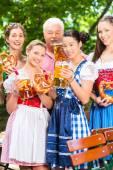 Beer garden - friends drinking in Bavaria Pub — Stock Photo