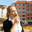 Young woman eats Ice cream — Stock Photo #79204410