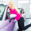 Woman choosing new car at dealership — Stock Photo #79205896