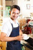 Asian Coffeeshop - barista presents coffee — Stock Photo