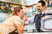Girl in cafe flirting with barista — Stock Photo