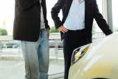 Man buying car from salesperson — Stock Photo