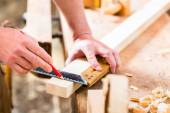 Carpenter with workpiece in carpentry — Stock Photo