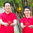 Father and son with Chinese new year gift — Stock Photo #79214938
