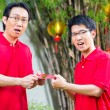 Father and son with Chinese new year gift — Stock Photo #79214966