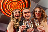 People with champagner in a bar — Stock Photo