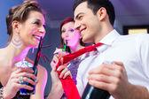 Woman flirting with barkeeper — Stock Photo