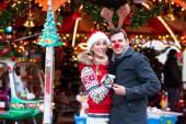 Couple on traditional Christmas market — Stock Photo