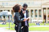 African couple doing sightseeing in city — Stock Photo