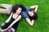 Latin Couple on meadow sleeping in summer — Stock Photo