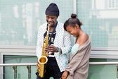 African couple playing Saxophone — Stock Photo