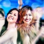 Girls partying on dance floor of disco nightclub — Stock Photo #79226562