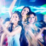 Girls partying on dance floor of disco nightclub — Stock Photo #79226642