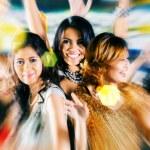 Girls partying on dance floor of disco nightclub — Stock Photo #79226654