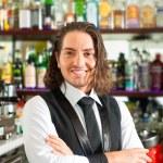 Barista or barman behind his bar — Stock Photo #79226764