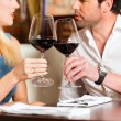Couple drinking red wine in restaurant — Stock Photo #79227762